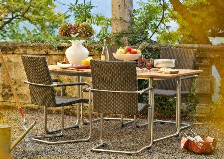 PRATO Tisch Teak mit PRATO Stühlen in Geflecht